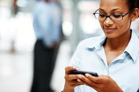 Woman texting at office
